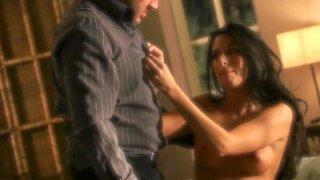 Hot brunette Nikki Daniels is sucking her man's dick image