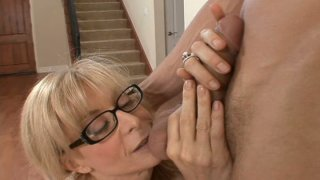 Image: Slutty housewife with big boobs Nina Hartley blows and rides young cock