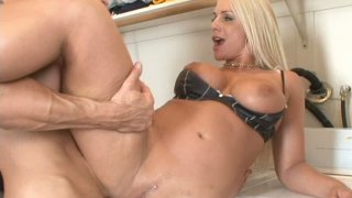 Busty blonde Sadie Swede rides on cock on the floor image