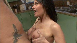 Busty brunette Eva Karera gives blowjob in kitchen image