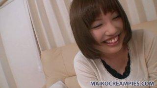 Shy chick Reiko Kawahara gets undressed for a tough fuck image