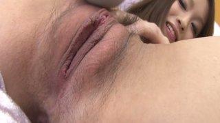 Petite Japanese cutie Nao Kojima toying her hairy pussy image