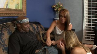 Image: Brutal black dude with huge cock gets a hot blowjob by Haley Sweet and Amanda Blow