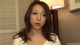 Cute and pretty face bitch Kanako posing on a cam and giving blowjob image