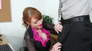 Redhead_secretary_Marie_McCray_gives_a_head_on_work_place image