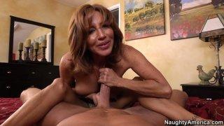 Image: POV video of mature mommy Tara Holiday giving blowjob and footjob
