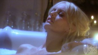 Kinky blondie Stormy Daniels provides a solid blowjob after the hot bath image