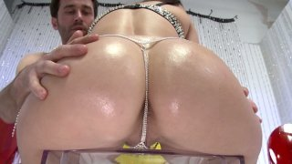 Glittering butt of Holly West gets plugged with a dildo and licked by James Deen image