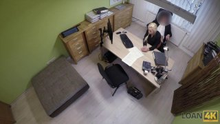Blonde whore is willing to fuck on the office table image