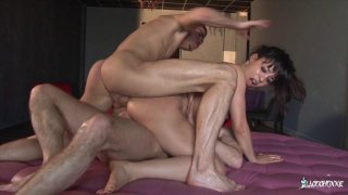 Asian slut has her holes double penetrated in a threesome image