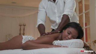 Mandingo fucks beautiful black client Nia Nacci on the massage table image