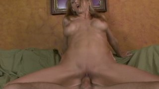 Horny slut Roxanne Hall sweats from riding on cock image