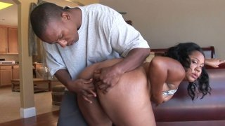 Plumpy ebony chick Jessica Allbutt blows cock on her knees image