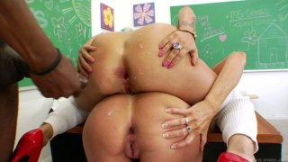 Naughty girls Darla Crane and Britney Stevens are getting a hard anal penetration in the college room image