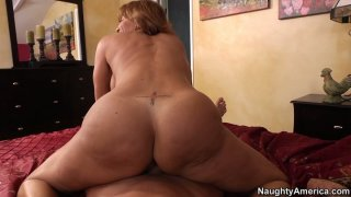 Image: Lustful curly haired mommy Tara Holiday rides cock on POV video