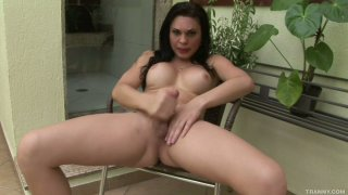 Shemale bitch Ana Paula Samadhi jerks her juicy cock image