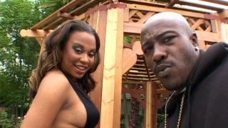 Big boobed ebony girl Kandi Kream gives blowjob image