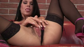 Brunette Lola wears stockings and rubs her wet pussy image