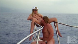 Curvaceous blonde Stormy Daniels blows dick of boat captain image