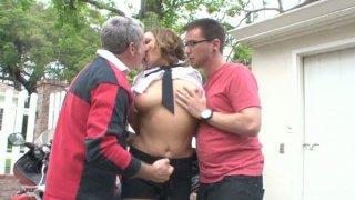 Image: Bonerific brunette MILF is getting fucked hard in MMF threesome outdoor