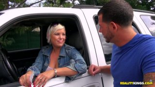 Image: Busty cute milf gets picked up in the car wash and flashes her tits
