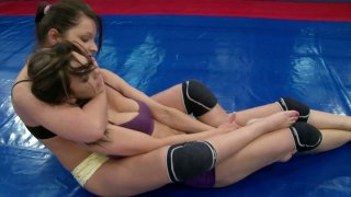 Sexy chicks Mellie and Lana S practice martial arts on the boxing ring image