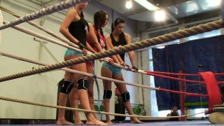 Brunette chick Emma Butt fights her girlfriends on the boxing ring image