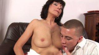 Bosomy brunette MILF Jane Black_gives head to her stud Steve Q image