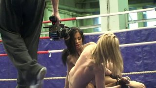 Jessica Moore wrestles with her girlfriend on the ring image