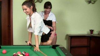 Lesbo hoochies Alysa and Lana having fun over the pool table image