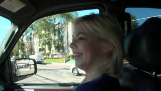 Kinky blonde whore Alice Frost gives a blowjob in a car image