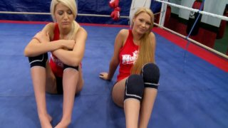 Two blonde bitches Antonya and Blanche give an interview before a furious fight on a ring image