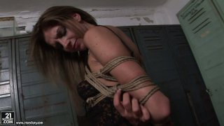 Seductive and kinky bitches Kathia Nobili and Bambi play dirty games in a locker room image
