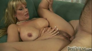 Busty blonde mom Olivia Parrish rides dick with her hairy cunt image