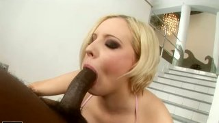 Seductive lady Lolly Blond blows big black tool and sucks it dry image