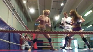 Celine Doll is fighting on a boxing ring and eats opponent's pussy image