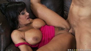 Voracious busty brunette Lisa Ann has a sexy time on the couch image