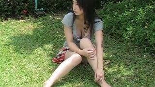Asian brunette babe Arisa Oda flaunts her body_outdoors image