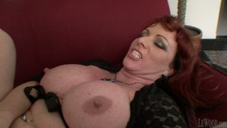 Redhead fattie Kylie Ireland gets her mature cunt pounded image