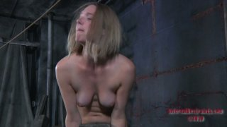 Horny chick in true slave hood Star is made to suck a dildo image