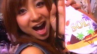 Buxom Japanese whore Hitomi Aizawa makes grimaces on camera image