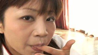 Playful Japanese teen Ami Kitazawa sucks three dicks_in turn image