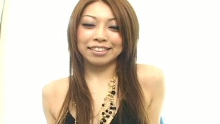 Naughty ginger Asian Nozomi Uehara lets her man_shave her pussy image