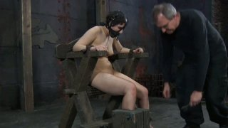 Pallid BDSM fan Marina gets tied up and wears a slave hood image