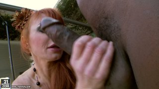 Scary ginger MILF Taylor Wane is doggyfucked by BBC image