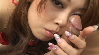 Curly narrow eyed cutie Nozomi Uehara sucks cock until it loads her mouth image
