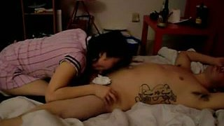 Black haired amateur_Asian chick_rides hairy dick on homemade video image