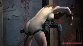 Redhead_bitch_Ashley_Graham_is_poked_with_a_sex_machine_while_being_locked_up_with_handcuffs image