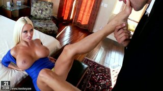 Majestic blonde sex pot Nikita Von James gets horny when the guy licks her feet image
