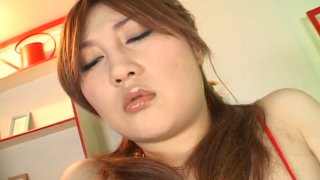 Perky Japanese slut Hiyori Konno masturbates with a dildo in a solo sex video image